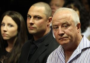 Olympic athlete Oscar Pistorius' father Henke Pistorius, right, with his children Carl, center,, and Aimee, left, watch as Oscar Pistorius walks in during his bail hearing at the magistrate court in Pretoria, South Africa, Friday, Feb. 22, 2013. (AP Photo/Themba Hadebe)