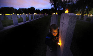 FAVOURITE PHOTO 2014  This is the image that stands out for me this year. Not only does it bridge the generations of Canadian veterans, but it reminds me that unless Canada and the world change, Connor may wind up a casualty of war himself one day. September 10, 2014   Seven-year-old Connor Chaulk checks out names on the rows of veteran graves at Brookside Cemetery candle-light vigil held to mark the anniversary of the start of the Second World War. Connor doesn't have any veteran relatives in Brookside but made a point of remembering his great grandfather, a Second World War veteran buried in Stonewall's cemetery.
