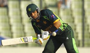 Pakistan's captain Misbah-ul-Haq plays a shot against Sri Lanka during the Asia Cup final cricket match in Dhaka, Bangladesh, Saturday, March 8, 2014. (AP Photo/A.M. Ahad)