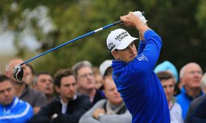 Sweden's Henrik Stenson plays a tee shot during day four of the World Match Play Championship at The London Club, golf course in Ash southeast England Saturday Oct. 18, 2014. Stenson is playing fellow countryman Jonas Blixt in a quarterfinal match. (AP Photo/Gareth Fuller/PA) UNITED KINGDOM OUT NO SALES NO ARCHIVE