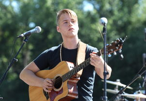 Keiffer McLean performs on the waterfront at The Forks Saturday during the Prairie Barge Festival.