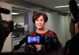 Theresa Oswald takes questions from the media in a scrum outside the NDP office Friday after officially signing the paperwork to enter the Manitoba NDP's leadership race.