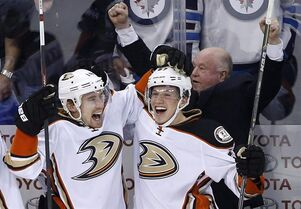 Anaheim Ducks' Tomas Fleischmann (14), Rickard Rakell (67) and head coach Bruce Boudreau celebrate a goal against the Winnipeg Jets during third period NHL game four playoff action in Winnipeg on Wednesday, April 22, 2015. The comeback kids from Calgary will see their third-period dopplegangers in the