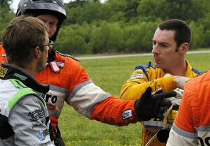 Simon Pagenaud, right, of France, and Sebastien Bourdais, left, also of France, exchange words after a crash during the IndyCar Grand Prix of Louisiana auto race, Sunday, April 12, 2015, in Avondale, La. (AP Photo/Jonathan Bachman)
