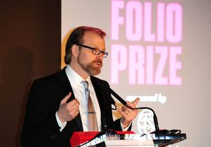 George Saunders gives a speech after winning the Folio Prize at the St Pancras Renaissance Hotel in London, Monday, March 10, 2014. The American writer has won the 40,000 pound ($67,000) Folio Prize for literature with his humorous and disturbing short-story collection