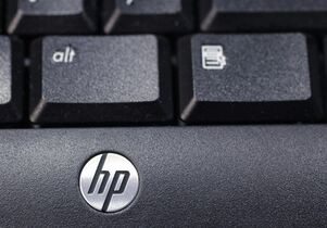 FILE - This Nov. 14, 2011 photo, shows the company logo on a Hewlett-Packard keyboard at the Micro Center computer store in Santa Clara, Calif. Hewlett-Packard is buying wireless networking company Aruba Networks for about $2.7 billion, the biggest acquisition by HP in recent years, the company announced Monday, March 2, 2015. (AP Photo/Paul Sakuma, File)