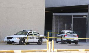 Police investigate a suspicious death at the parking garage at the corner of Hargrave Street and Ellice Avenue on Saturday.