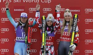 Austria's Anna Fenninger, center, winner of an alpine ski World Cup women's super-G event, celebrates on the podium with second placed Tina Maze, of Slovenia, left, and third placed Lindsey Vonn, of United States, in Bansko, Bulgaria, Monday, March. 2, 2015. (AP Photo/Giovanni Auletta)