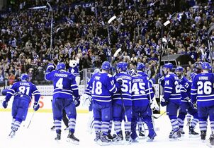 The Toronto Maple Leafs salute the crowd following a win over the Detroit Red Wings in an NHL hockey game in Toronto on Saturday, Nov. 22, 2014. (AP Photo/The Canadian Press, Frank Gunn)