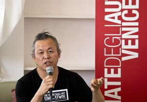 South Korean director Kim Ki-duk speaks during a press conference for his film One on One at the 71st edition of the Venice Film Festival in Venice, Italy, Wednesday, Aug. 27, 2014. Kim's t-shirt reads,