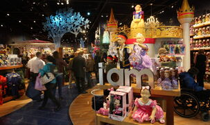 Customers rush into the new Disney store at Polo Park on Wednesday.
