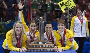 Manitoba skip Jennifer Jones (from left) third Kaitlyn Lawes, second Jill Officer and lead Dawn McEwen celebrate their Canadian championship in the Scotties Tournament of Hearts Sunday.