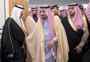 In this Sunday, Jan. 25, 2015 photo provided by the Saudi Press Agency, Prince Miteb bin Abdul Aziz, son of Saudi King Abdullah bin Abdul Aziz al-Saud, left, and newly enthroned King Salman, center, receive dignitaries who arrived to give their condolences for Saudi King Abdullah, who died early Friday at age 90, in Riyadh, Saudi Arabia. (AP Photo/SPA)