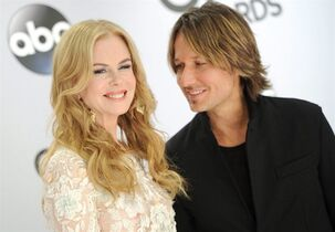 Nicole Kidman, left, and Keith Urban arrive at the 48th annual CMA Awards at the Bridgestone Arena in Nashville, Tenn., on Nov. 5, 2014. Keith Urban says wife Nicole Kidman and their family will accompany him to Niagara Falls, Ont., for his New Year's Eve performance. THE CANADIAN PRESS/Evan Agostini/Invision/AP