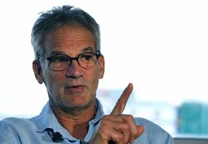 "FILE - In this Sept. 17, 2014 file photo, Colorado-based author Jon Krakauer gestures during an interview in Denver. Krakauer doesn't plan a book tour to promote his latest work, ""Missoula: Rape and the Justice System in a College Town."" But he does plan one public appearance in Missoula, where he'll face angry critics who say his portrayal of the small town is unfair. (AP Photo/Brennan Linsley, File)"