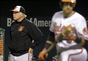 Baltimore Orioles manager Buck Showalter watches from the dugout as Ryan Flaherty, front right, prepares for an at-bat in the fourth inning of a baseball game against the Toronto Blue Jays, Tuesday, Sept. 16, 2014, in Baltimore. (AP Photo/Patrick Semansky)