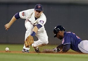 Cleveland Indians' Chris Dickerson, right, steals second base as the throw gets past Minnesota Twins second baseman Brian Dozier in the seventh inning of a baseball game, Wednesday, Aug. 20, 2014, in Minneapolis. The Indians won 5-0. (AP Photo/Jim Mone)
