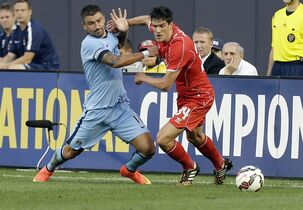 Manchester City's Aleksandar Kolarov (11) and Liverpool's Martin Kelly (34) fight for control of the ball in the first half of a Guinness International Champions Cup soccer tournament match Wednesday, July 30, 2014, in New York. (AP Photo/Frank Franklin II)