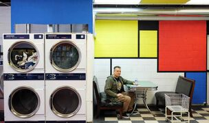 Elder De Andrade in his laundromat, The Washeteria, at 556 Keenleyside St.