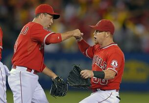 Los Angeles Angels' John McDonald, left, and Kole Calhoun congratulate each other after they defeated the Seattle Mariners 5-0 in a baseball game, Wednesday Sept. 17, 2014, in Anaheim, Calif. (AP Photo/Mark J. Terrill)