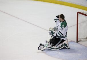 Dallas Stars goalie Kari Lehtonen, of Finland, kneels on the ice after allowing a goal by Anaheim Ducks' Ryan Getzlaf during the first period in Game 1 of the first-round NHL hockey Stanley Cup playoff series on Wednesday, April 16, 2014, in Anaheim, Calif. (AP Photo/Jae C. Hong)