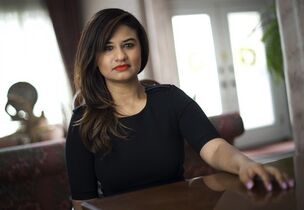 Nadia Ali, who suffers from severe motion sickness, poses in her Mississauga home on Friday, April 18, 2014. Ali, 26, is not able to read on the subway, bus, plane, or car, and can't sit in the backseat of a car without feeling queasy. THE CANADIAN PRESS/Darren Calabrese