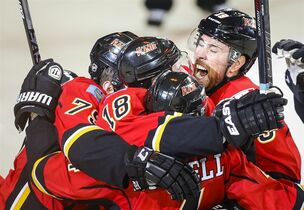 Calgary Flames Matt Stajan (18) celebrates his game-winning goal with teammates during third period NHL first round game six playoff hockey action against the Vancouver Canucks in Calgary, Saturday, April 25, 2015.THE CANADIAN PRESS/Jeff McIntosh