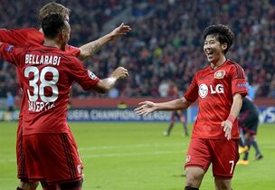 CORRECTS MONTH - Leverkusen's Son Heung-min, right, celebrates with his teammates after scoring his side's 2nd goal during the Champions League group C soccer match between Bayer 04 Leverkusen and SL Benfica at the BayArena stadium in Leverkusen, Germany, Wednesday, Oct. 1, 2014. (AP Photo/Martin Meissner)