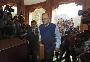 Indian Finance Minister Arun Jaitley arrives at the Parliament House to present Union Budget for the year 2015-16, in New Delhi, India, Saturday, Feb. 28, 2015. The Economic Survey, an annual report on the state of Asia's third-largest economy, said Friday that India's economy will grow more than 8 percent in the upcoming financial year, which would make it the world's fastest growing economy, surpassing China. (AP Photo/Manish Swarup)