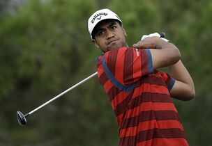 Tony Finau drives off the first tee during the third round of the Shriners Hospitals for Children Open golf tournament Saturday, Oct. 18, 2014, in Las Vegas. (AP Photo/John Locher)
