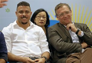 Brazil's former soccer player Ronaldo, left, and FIFA Secretary General Jerome Valcke attend a news conference after inspecting the unfinished Itaquerao stadium in Sao Paulo, Brazil, Tuesday, April 22, 2014. The stadium will host the World Cup opener match between Brazil and Croatia in June 12. (AP Photo/Andre Penner)
