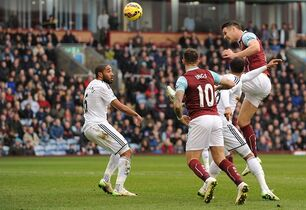 Burnley's Ashley Barnes, top, has a shot on goal during their English Premier League soccer match against Swansea City at Turf Moor, Burnley, England, Saturday, Feb. 28, 2015. (AP Photo/Ryan Browne, PA Wire) UNITED KINGDOM OUT - NO SALES - NO ARCHIVES