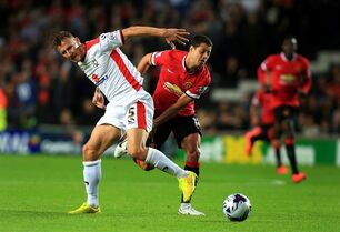 MK Dons' Antony Kay, left, tussles with Manchester United's Javier Hernandez during the League Cup Second Round match at Stadium:mk, Milton Keynes, England, Tuesday Aug. 26, 2014. MK Dons defeated Manchester United 4-0. (AP Photo/PA, Nick Potts) UNITED KINGDOM OUT NO SALES NO ARCHIVE
