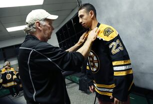 Boston Bruins hockey center Chris Kelly is prepped for a formal head shot by team photographer Steve Babineau at TD Garden in Boston, Thursday, Sept. 18, 2014. (AP Photo/Elise Amendola)