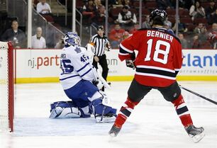 Toronto Maple Leafs goalie Jonathan Bernier (45) makes a save on a shot by the New Jersey Devils as right wing Steve Bernier (18) watches during the second period of an NHL hockey game, Wednesday, Jan. 28, 2015, in Newark, N.J. (AP Photo/Julio Cortez)