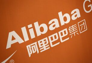 FILE - In this Sept. 19, 2014 file photo, the Alibaba logo is displayed during the company's IPO at the New York Stock Exchange, in New York. On Thursday, Jan. 29, 2015, Alibaba Group said its net income fell as it faced higher one-time costs but its adjusted earnings beat expectations. (AP Photo/Mark Lennihan, File)