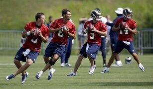 St. Louis Rams quarterbacks, from left, Austin Davis, Sam Bradford, Garrett Gilbert and Shaun Hill drop back to pass during training camp at the NFL football team's practice facility Friday, July 25, 2014, in St. Louis. (AP Photo/Jeff Roberson)