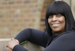 In this April 16, 2015 photo Mishaun Cannon, 48, poses for a portrait in Markham, Ill. Cannon unexpectedly lost a good-paying hospital job last year and has been pursuing a career-switch master's degree, signed up for Medicaid in January. She was surprised to learn she likely would qualify for food stamps too. (AP Photo/M. Spencer Green)