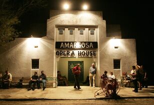 FILE -In this Oct. 1, 2005 file photo, patrons wait for the doors to open at the Amargosa Opera House in Death Valley Junction, Calif., to see a performance. The town once thrived while a local borax mine and railroad were still in operation. By the late 1920s, the town was little more than a tourist stop on the way to the park. Today most of the buildings are gone but the town remains a draw thanks to a hotel and the restored opera house. (AP Photo/The Las Vegas Sun, Sam Morris, File) LAS VEGAS REVIEW-JOURNAL OUT; MAGS OUT; NO SALES; MANDATORY CREDIT