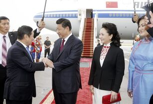 In this photo released by China's Xinhua news agency, Chinese President Xi Jinping, second from left, and his wife Peng Liyuan, second from right, are greeted by Mongolian Prime Minister Norov Altankhuyag and his wife Khonichin Selenge at the airport in Ulan Bator, Mongolia, Thursday, Aug. 21, 2014. Landlocked Mongolia is hoping to secure better access to Chinese ports as Xi became the first Chinese head of state in more than a decade to visit this sprawling nation sandwiched between China and Russia. (AP Photo/Xinhua, Ju Peng) NO SALES