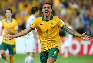 Australia's Tim Cahill celebrates after scoring his second goal during the AFC Asia Cup quarterfinal soccer match between China and Australia in Brisbane, Australia, Thursday, Jan. 22, 2015. (AP Photo/Tertius Pickard)
