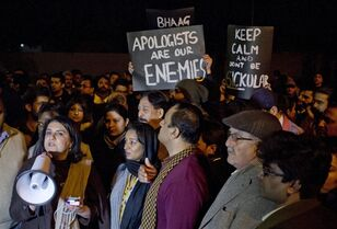 Members of a civil society group rally to condemn the Taliban for the killings of the students in Tuesday's attack on a military-run school in Peshawar, during a candlelight vigil near Red Mosque in Islamabad, Pakistan, Friday, Dec. 19, 2014. Hundreds of human rights activists rallied against a pro-Taliban cleric outside his Islamabad mosque to condemn him for not speaking against the militants who killed 148 people, mostly children, in Peshawar. (AP Photo/B.K. Bangash)