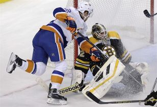 Boston Bruins goalie Niklas Svedberg (72), of Sweden, makes a save as he is pressured by New York Islanders left wing Josh Bailey, left, during the first period of an NHL hockey game in Boston, Thursday Oct. 23, 2014. (AP Photo/Charles Krupa)