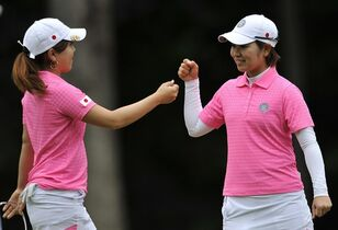 Mika Miyazato, right, and Mamiko Higa, of Japan, celebrate after putting on the first hole during the first round of the International Crown LPGA golf tournament Thursday, July 24, 2014, in Baltimore.(AP Photo/Gail Burton)