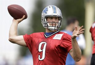 Detroit Lions quarterback Matthew Stafford throws during a NFL football training camp in Allen Park, Mich., Tuesday, July 29, 2014. (AP Photo/Paul Sancya)