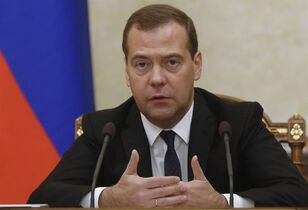 Russian Prime Minister Dmitry Medvedev heads the Cabinet meeting in the government headquarters in Moscow, Russia, Thursday, Sept. 18, 2014. THE CANADIAN PRESS/AP, RIA Novosti, Dmitry Astakhov, Government Press Service