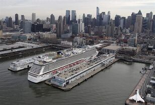 FILE - In a Dec. 1, 2013 aerial file photo, the cruise ship Norwegian Breakaway is berthed on the westside of Manhattan in New York. Norwegian Cruise Line is getting into the luxury cruise business by acquiring Prestige Cruises International in a deal worth about $3 billion. Shares of Norwegian jumped more than 14 percent before the opening bell Tuesday, Sept. 2, 2014. (AP Photo/Mark Lennihan)