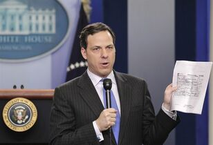 "FILE - IN this April 27, 2011 file photo, then ABC News' Chief White House Correspondent Jake Tapper holds up a copy of the president's birth certificate, released by the White House today, at the White House briefing room in Washington. Tapper will take over as host of CNN's Sunday morning public affairs program ""State of the Union"" in June, 2015. The former ABC newsman, who hosts a weekday afternoon program on CNN, replaces Candy Crowley. She left CNN in December and a rotating series of substitutes has been filling in ever since.(AP Photo/J. Scott Applewhite)"