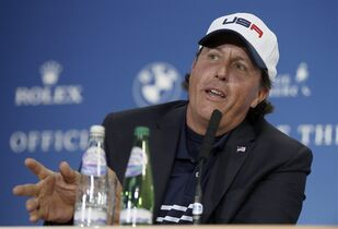 Phil Mickelson of the US speaks during a press conference after Europe won the 2014 Ryder Cup golf tournament at Gleneagles, Scotland, Sunday, Sept. 28, 2014. (AP Photo/Alastair Grant)