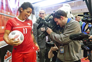 National team player Desiree Scott shows off her new kit during the official unveiling of the new Umbro Canada kit to be worn by Canada's National Teams in 2015, in Edmonton, Alta., on March 20. Scott was officially confirmed as a member of Team Canada Monday.